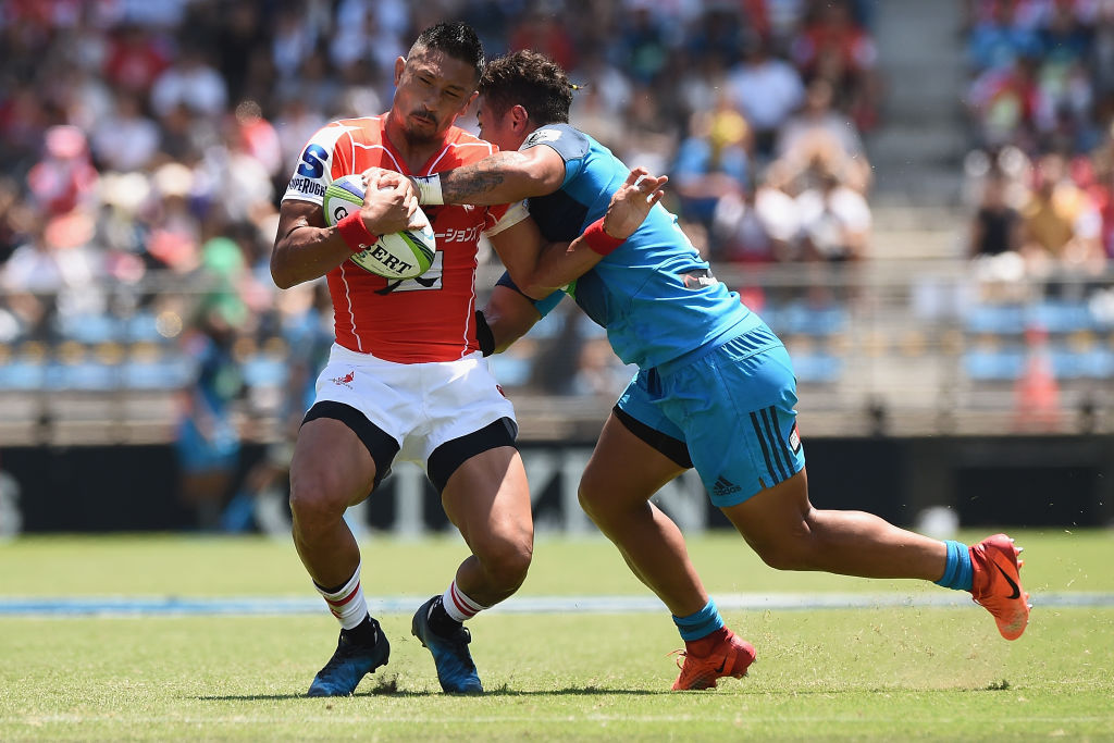Fumiaki Tanaka of the Sunwolves is tackled by Augustine Pulu of the Blues. Photo: Getty