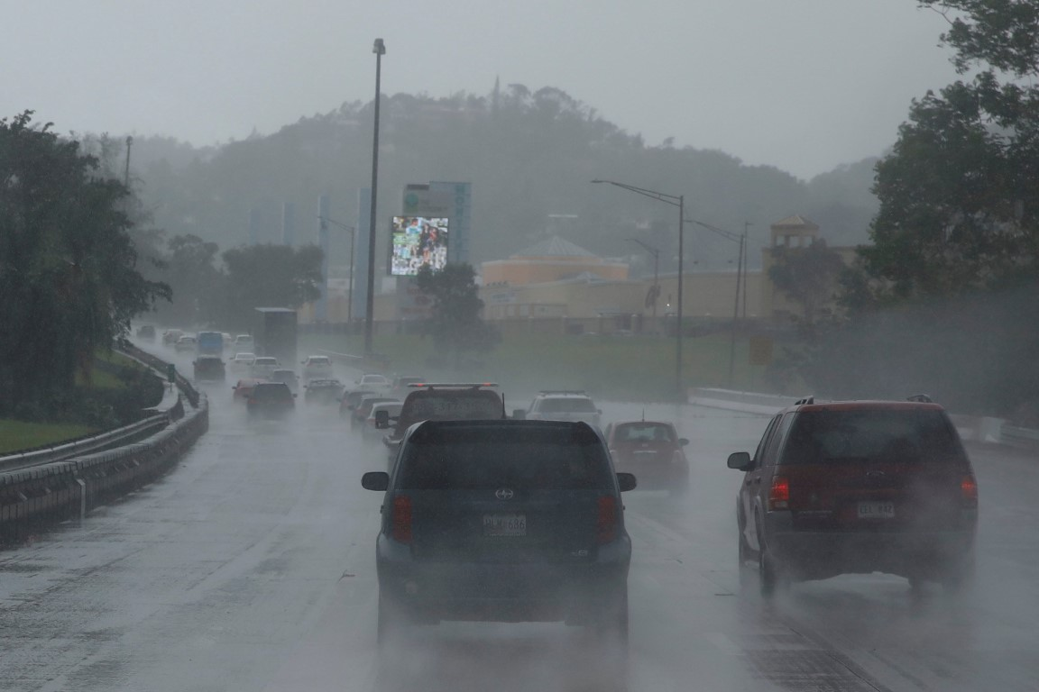 Cars on a highway during rain before the arrival of the Hurricane Maria in San Juan, Puerto Rico....