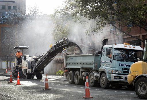 Contractors remove asphalt from Cumberland St by the University of Otago this week for the one...