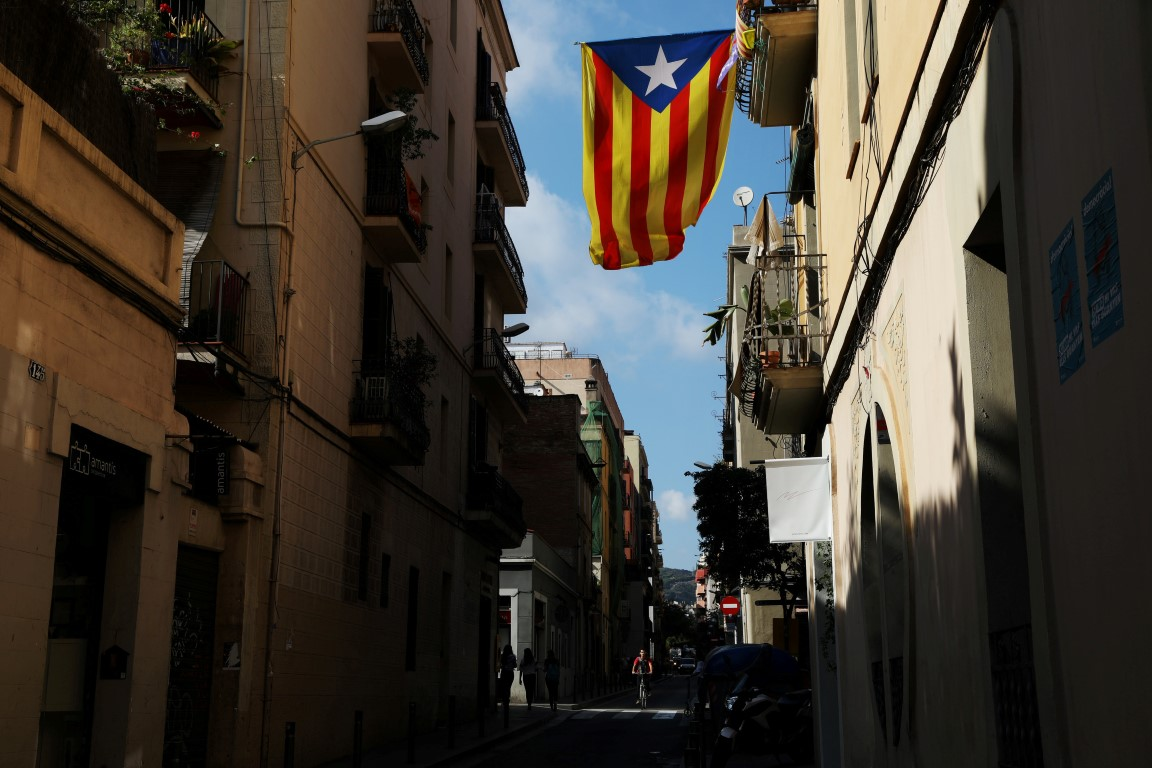 A Catalan separatist flag hangs from a balcony in Barcelona. Photo Getty