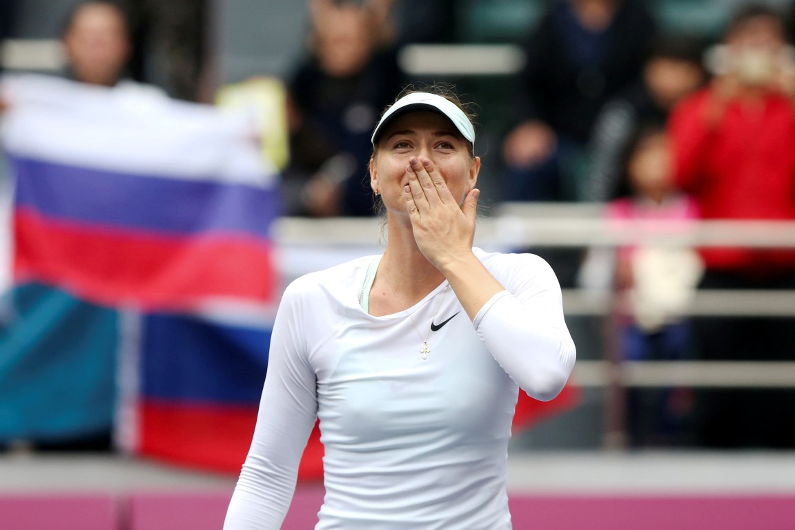 Maria Sharapova celebrates after winning the match against Aryna Sabalenka. Photo Reuters