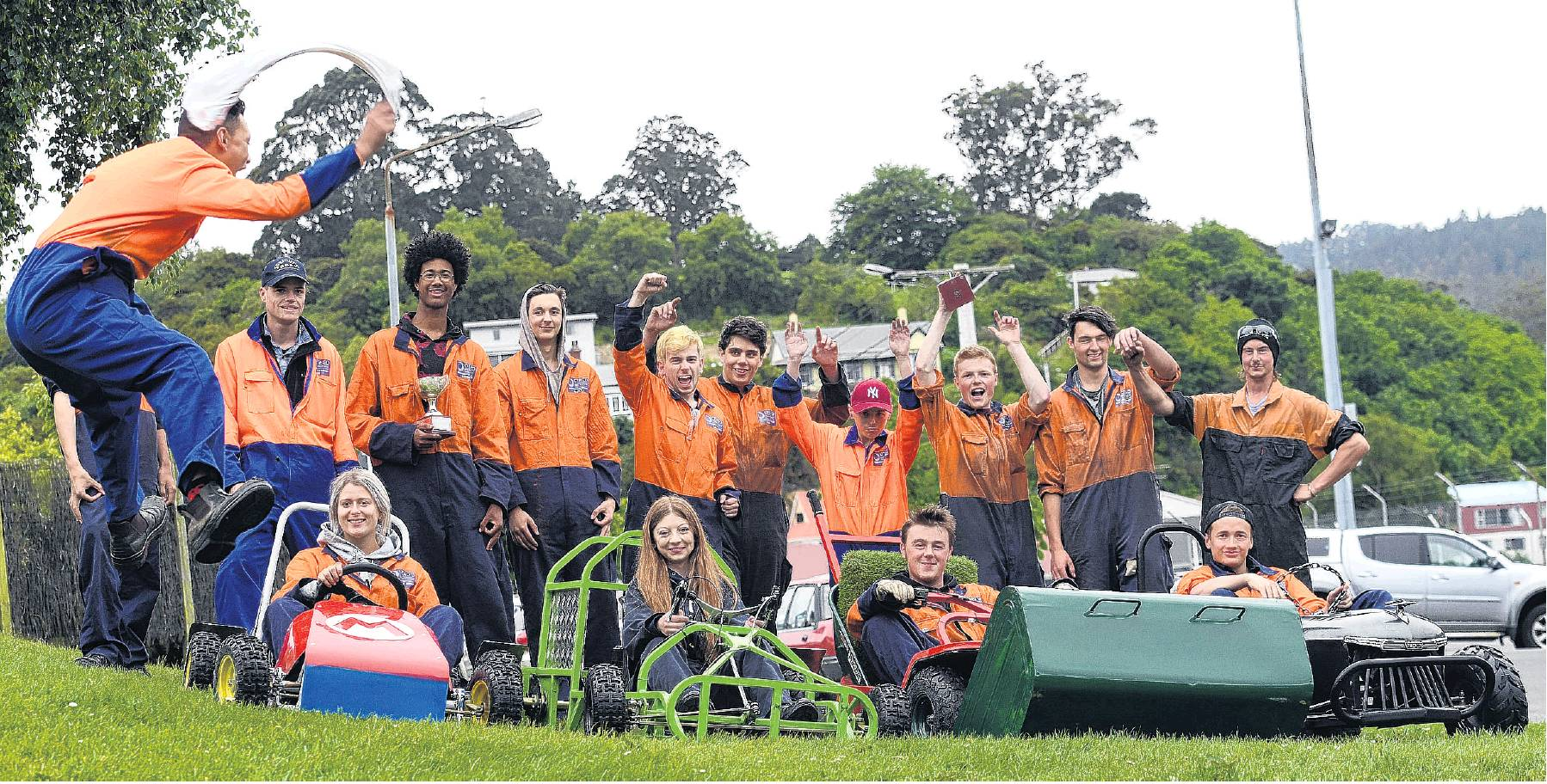 Otago Polytechnic student Mason Lee (17) gives the go signal for grass kart drivers (from left)...