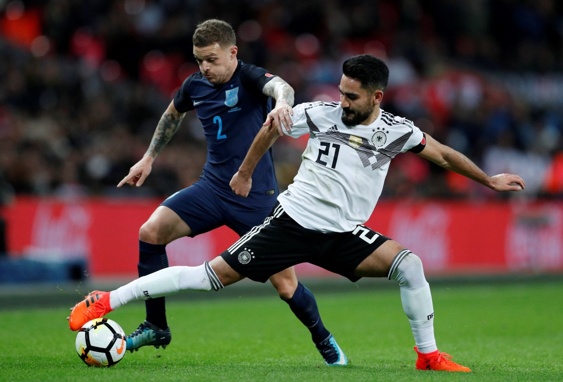 Germany's Ilkay Gundogan (R) in action with England's Kieran Trippier. Photo: Reuters