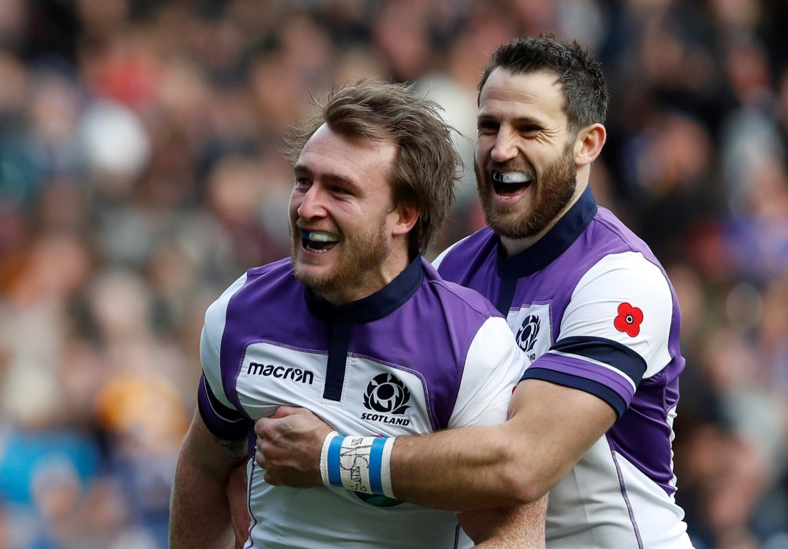 Scotland's Stuart Hogg celebrates scoring their first try with Tommy Seymour. Photo: Reuters