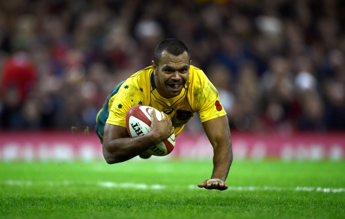 Kurtley Beale dives over to score for Australia. Photo Reuters