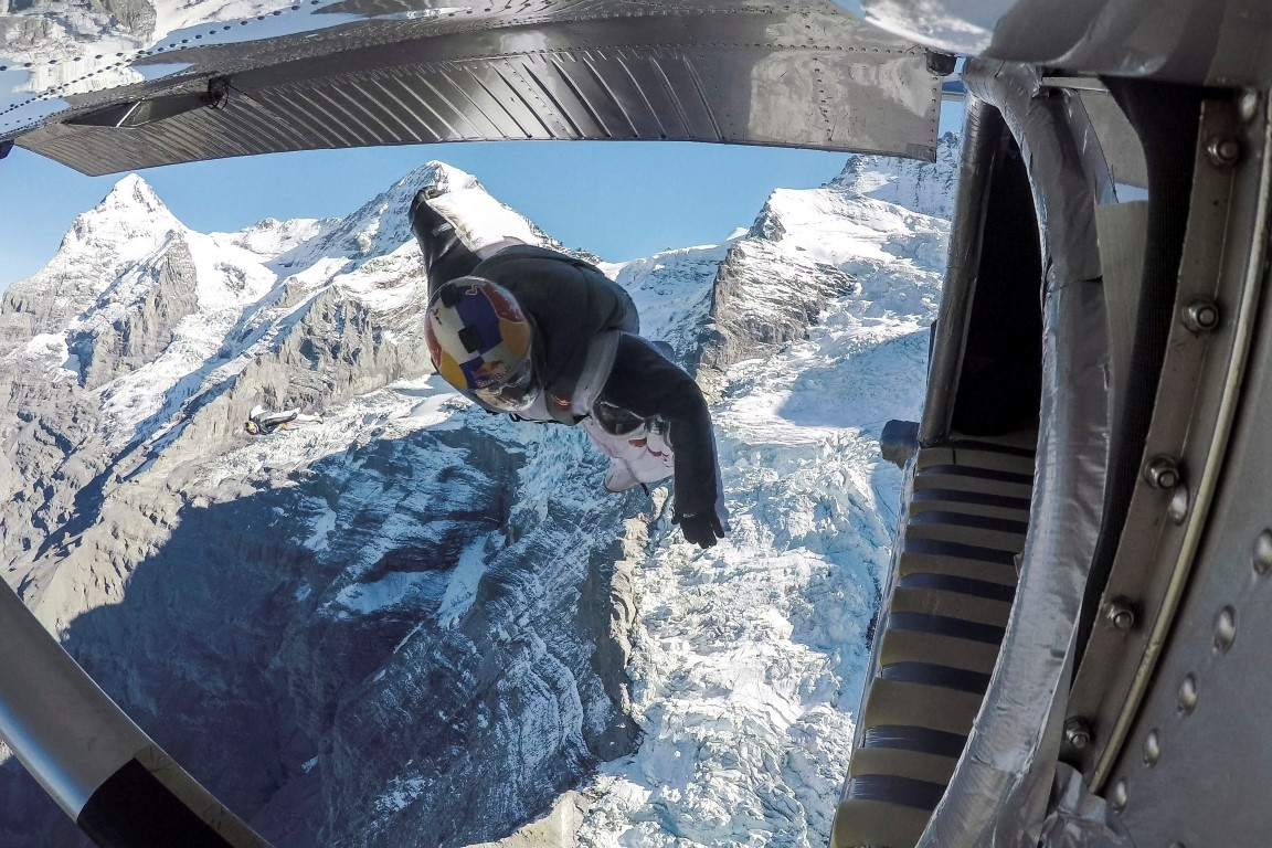 Wingsuit flyers jump into plane mid-air