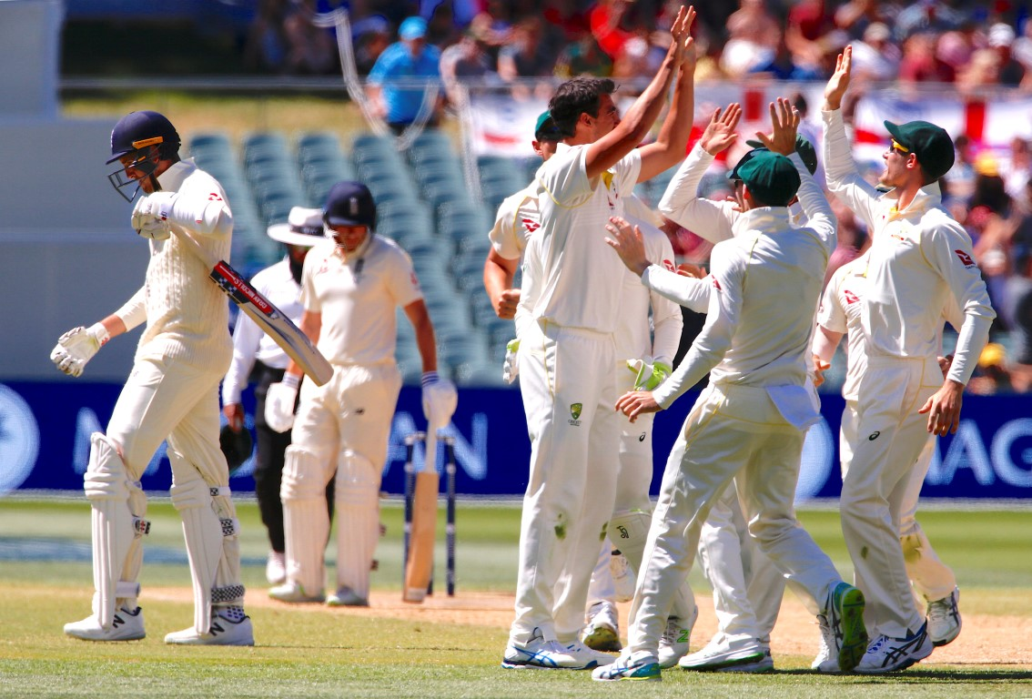 Australian players celebrate the dismissal of England's Craig Overton