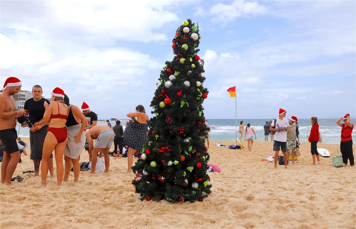 people celebrate christmas day on sydneys bondi beach photo reuters