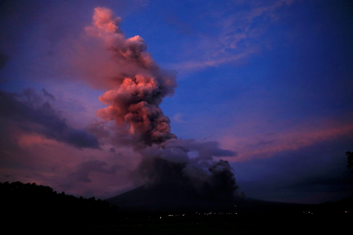 Tens of thousands flee as Philippines volcano spews ash three miles high