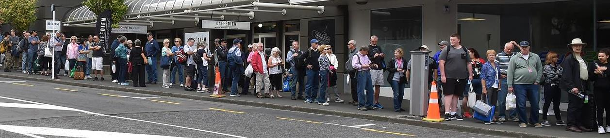 Cruise ship passengers wait in Moray Pl yesterday for a bus back to Port Chalmers. Photo: Shawn...