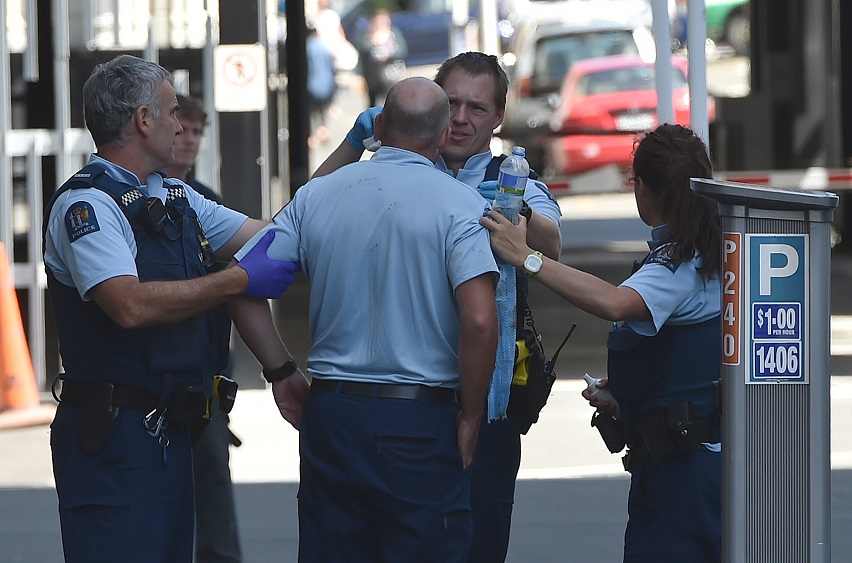 Police attend to an injured colleague after the incident in central Dunedin. Photo: Gregor...