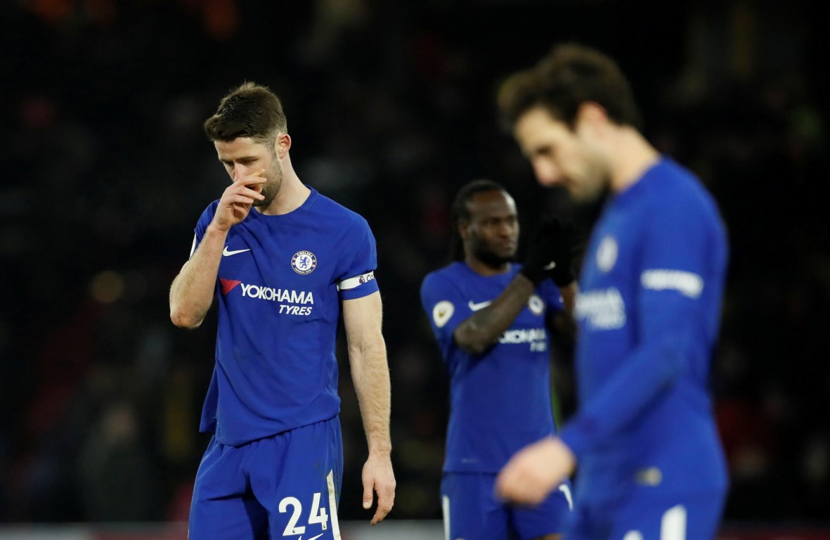 Dejected Chelsea players after the match. Photo Reuters