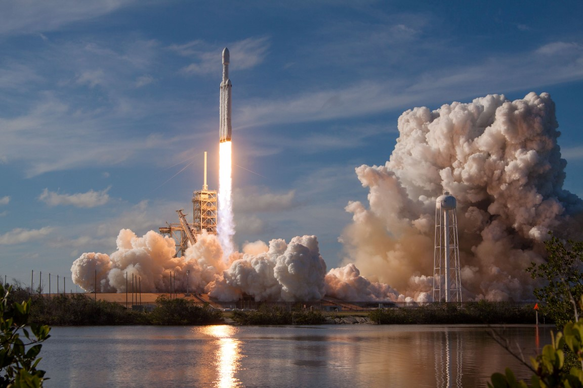 The SpaceX Falcon Heavy rocket lifts off from launch pad 39-A at the Kennedy Space Center in Cape...