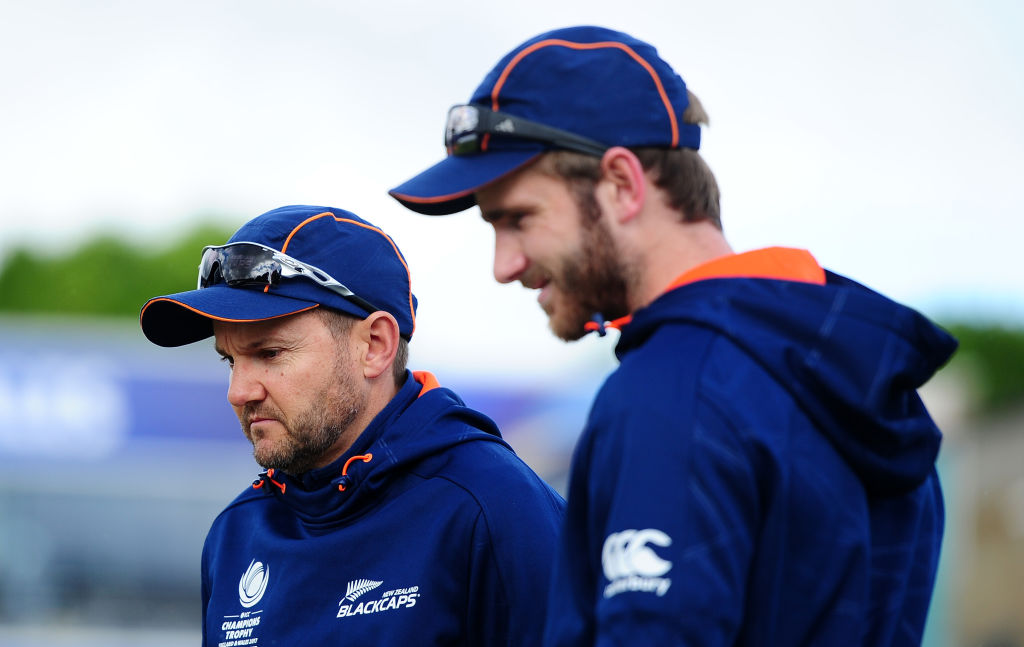 Former New Zealand international Simon Doull says captain Kane Williamson (R) and coach Mike...