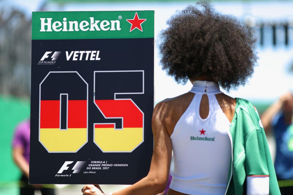 Sebastian Vettel's ''grid girl' stands on the grid before last year's Brazilian Grand Prix in Sao...