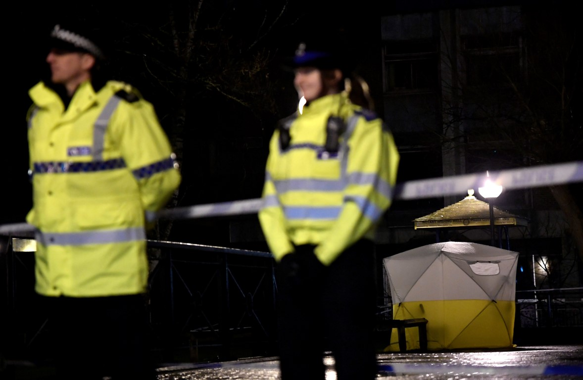 Police stand guard beside a cordoned-off area in Salisbury, southern England, after Sergei...