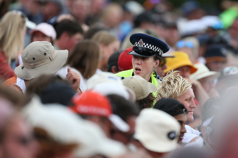 A police officer tries to calm supporters during the match. Photo: Getty Images
