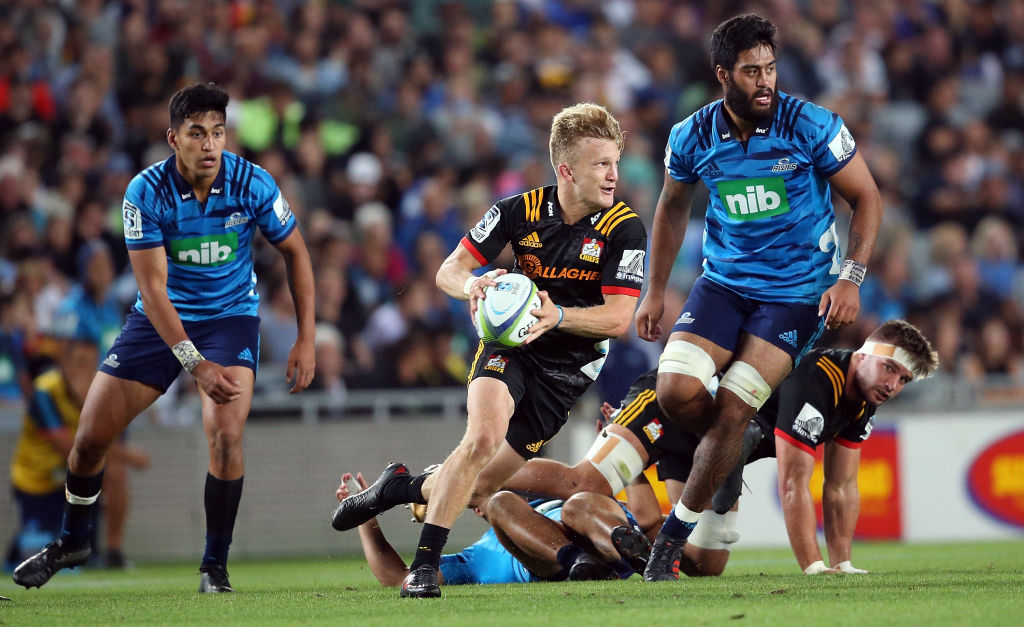 Damian McKenzie makes a run for the Chiefs against the Blues. Photo: Getty