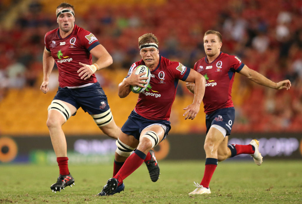 Adam Korczyk runs the ball up for the Reds against the Brumbies. Photo: Getty