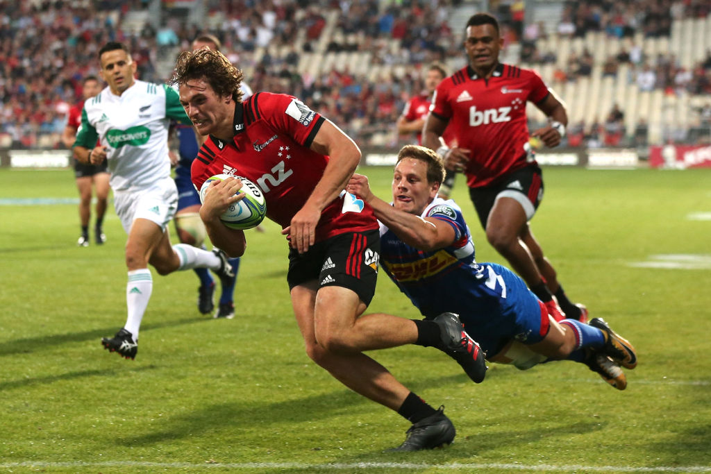 George Bridge runs in to score for the Crusaders against the Stormers. Photo: Getty