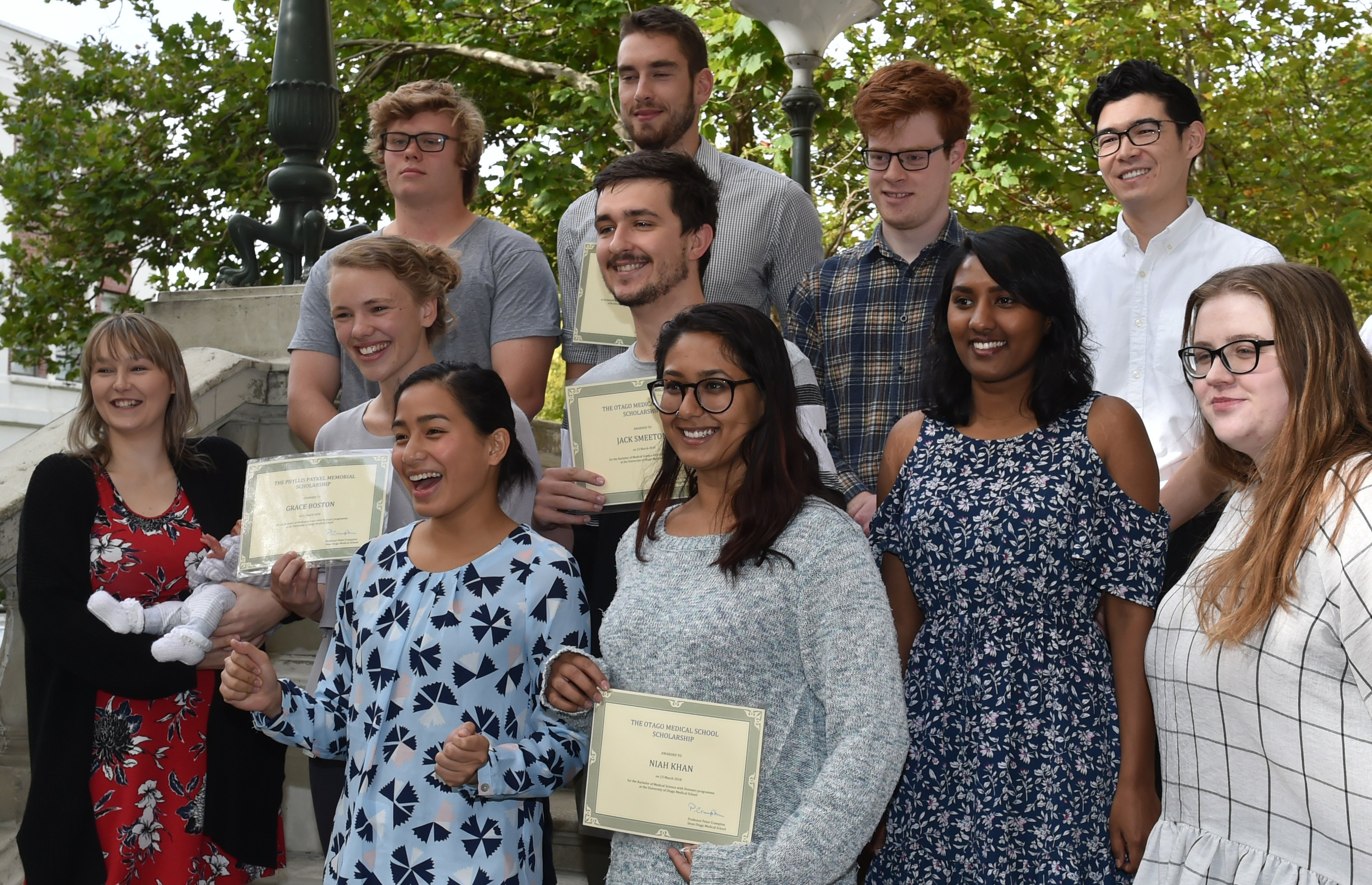 University of Otago bachelor of medical science honours award recipients are (from left, front) Mary Cane Demecillo, Niah Khan, (second row ) Bryony Harrison and her son Aurelius Yates, Grace Boston, Jack Smeeton, Danushi Peiris, Laura Bolger, (back row)