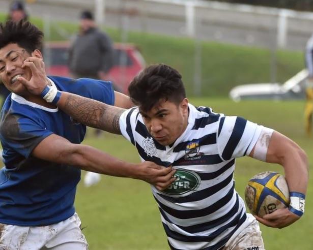 Otago Boys' High School flanker Josiah Lesa fends off Southland Boys' High School centre Junior...