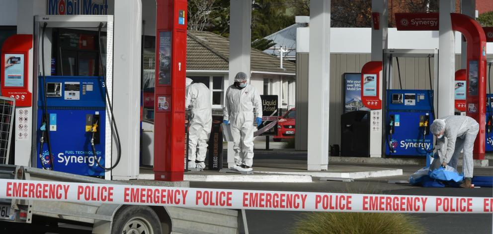 Police conducted a scene examination at Mobil Forbury following the alleged assault. Photo:...