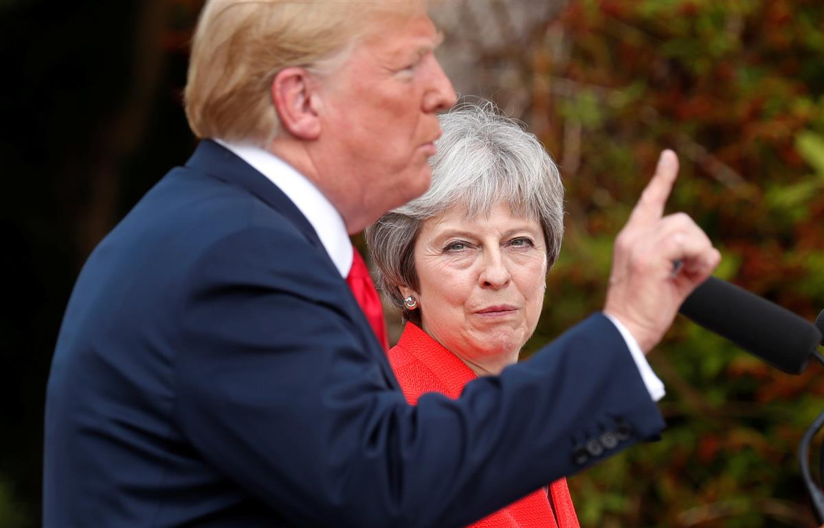 US President Donald Trump and British Prime Minister Theresa May hold a press conference after...