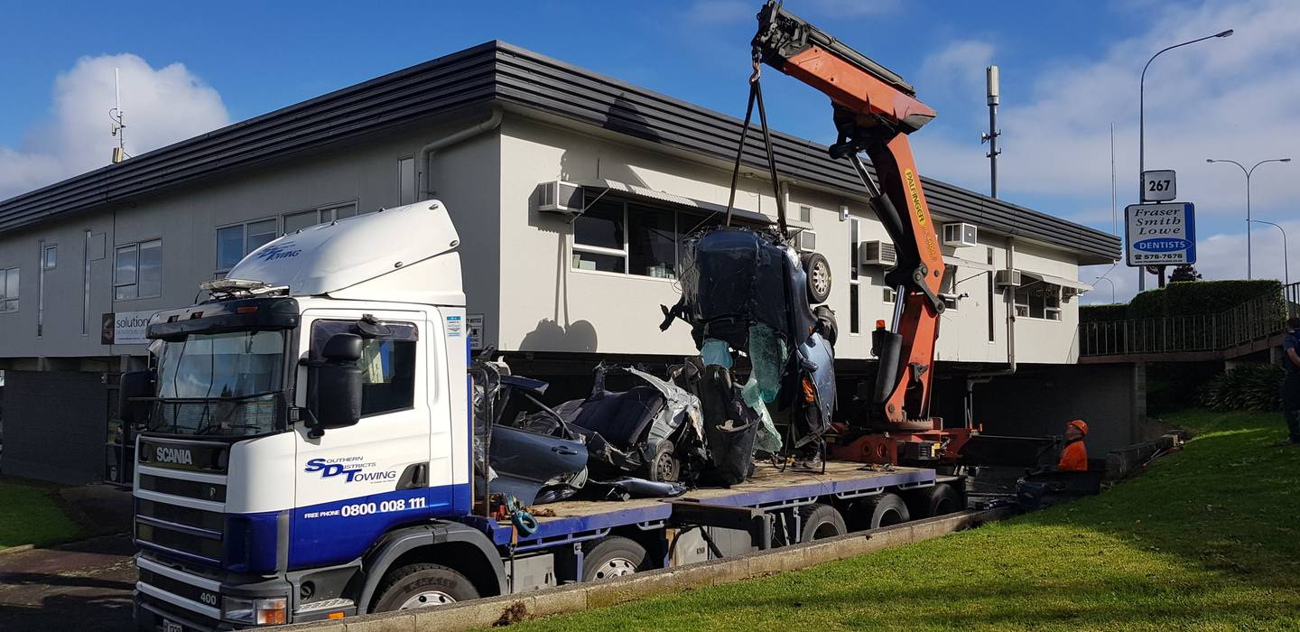 The shattered wreckage is removed from the crash scene. Photo: NZME
