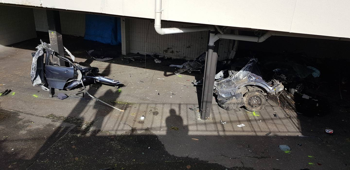 The car split into at least four parts after crashing into the building. Photo: NZME