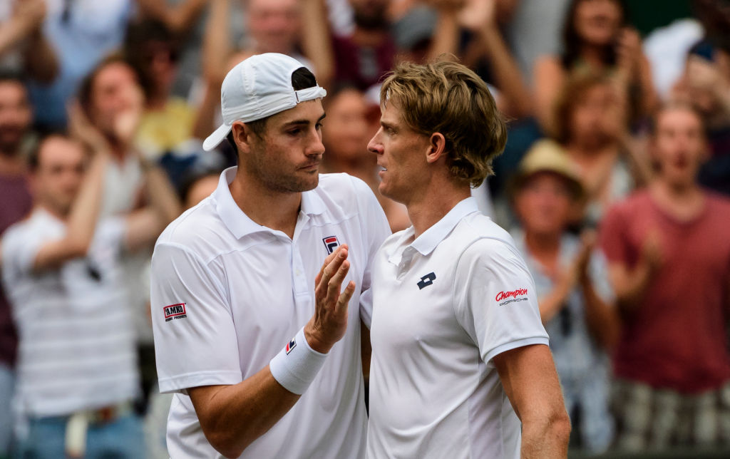 Kevin Anderson (R) commiserates with John Isner after the match. Photo: TPN/Getty Images