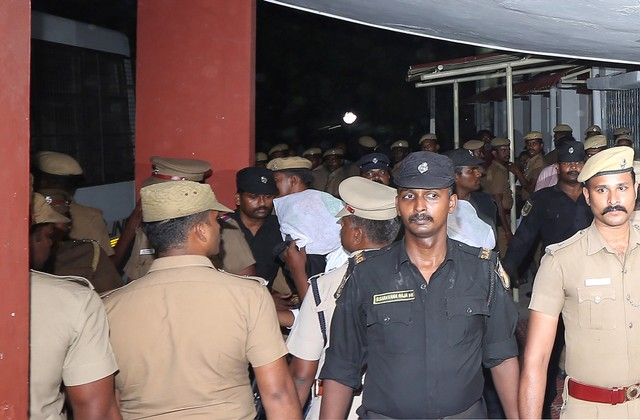 Police escort one of the men (face covered) accused of raping a 12-year girl inside the high court premises in Chennai. Photo: Reuters