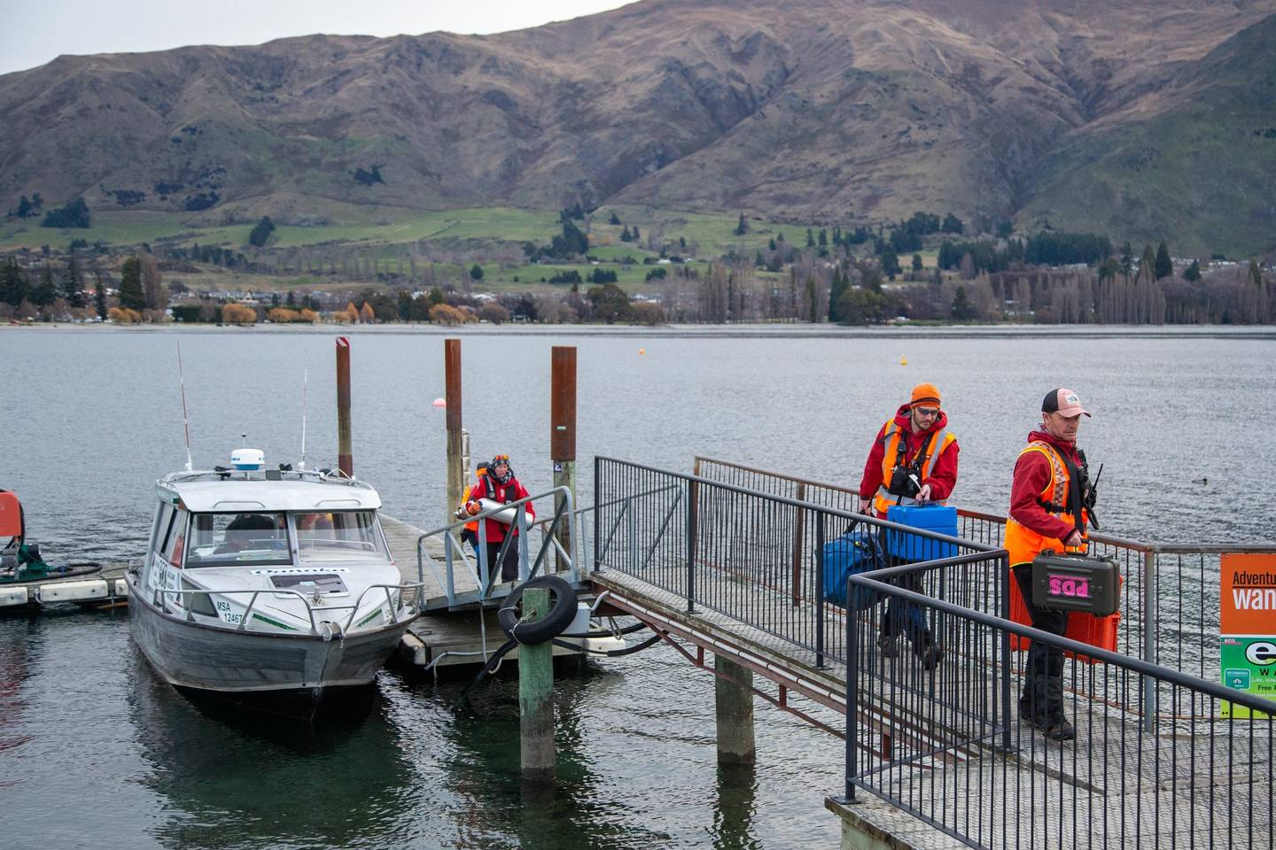 Dive tanks brought ashore on Lake Wanaka during the search for helicopter pilot Matthew Wallis....