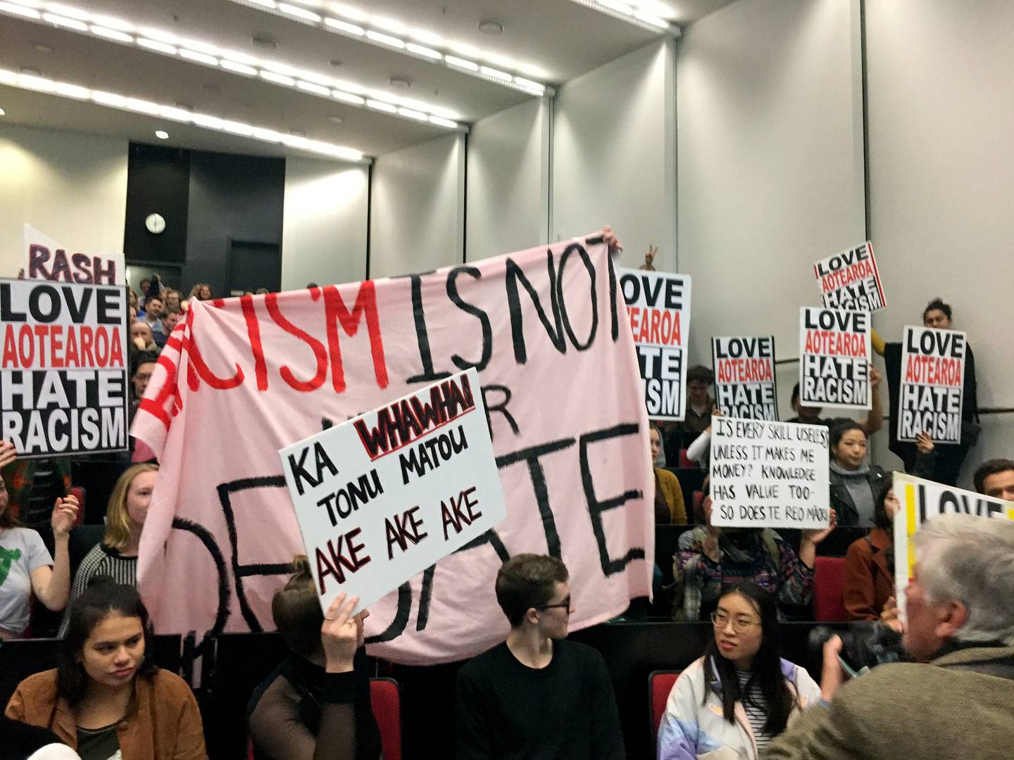 Protesters inside the freedom of speech debate at the University of Auckland where Don Brash...