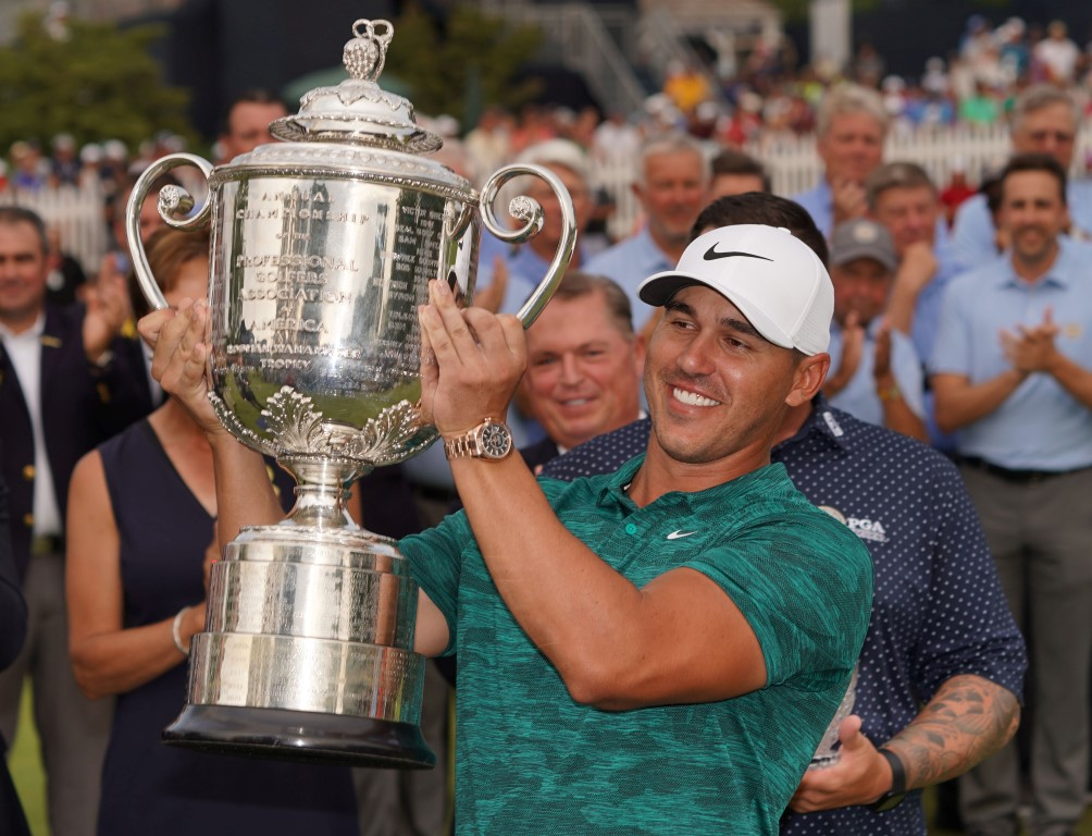 Brooks Koepka hoists the Wanamaker Trophy after winning the PGA Championship at Bellerive Country...