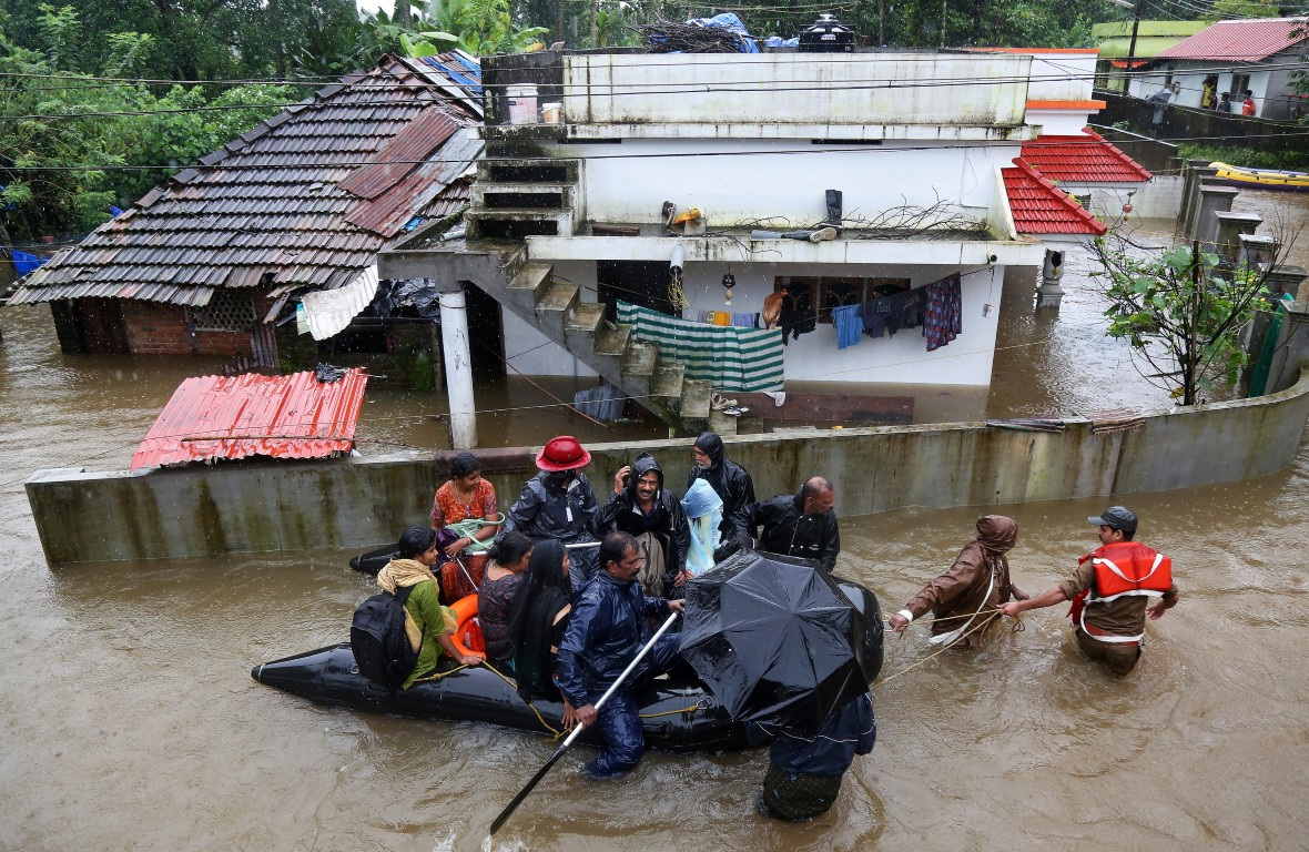 People evacuated from rooftops after Kerala floods kill 164