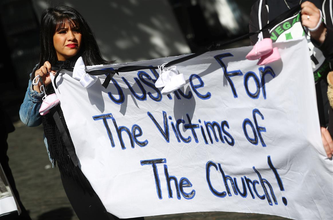 Protesters in Dublin hold banners during a demonstration against clerical sex abuse.Photo: Reuters