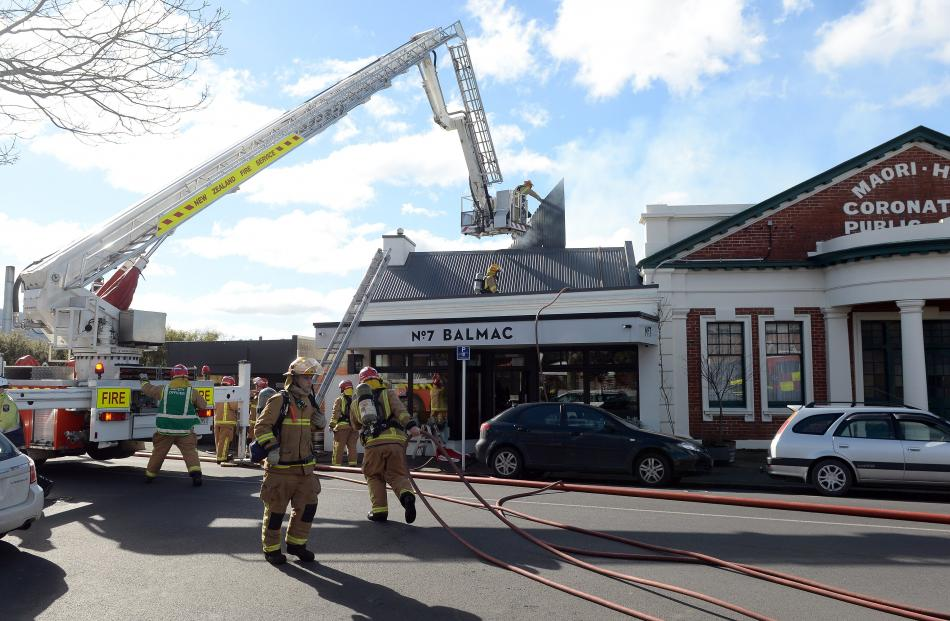 Firefighters rip open the roof of popular Dunedin restaurant No7 Balmac to battle a blaze which...