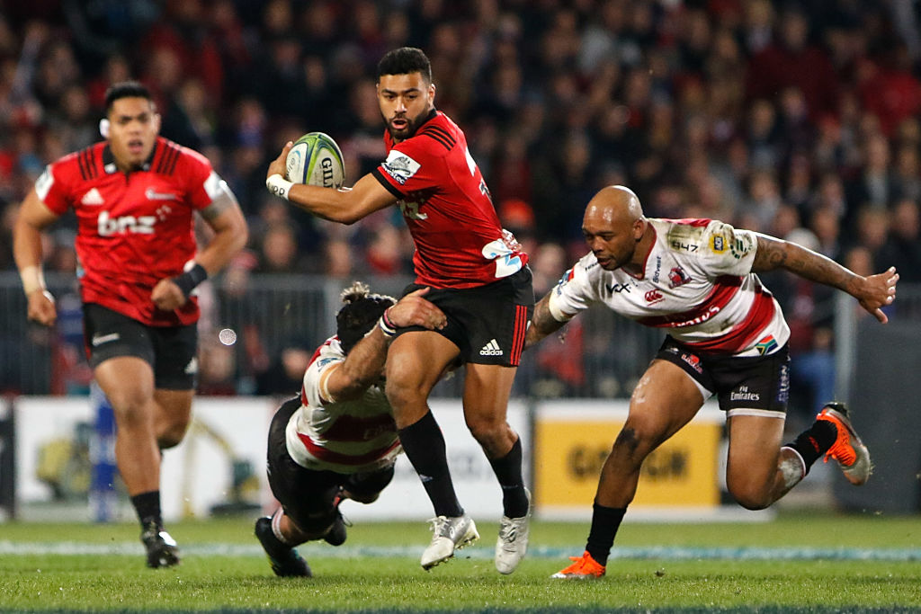 Richie Mo'unga makes a break for the Crusaders against the Lions during the Super Rugby final....