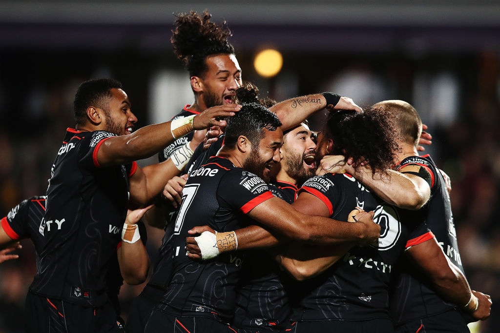 Warriors players celebrate a try to Agnatius Paasi during their match against the Panthers. Photo...