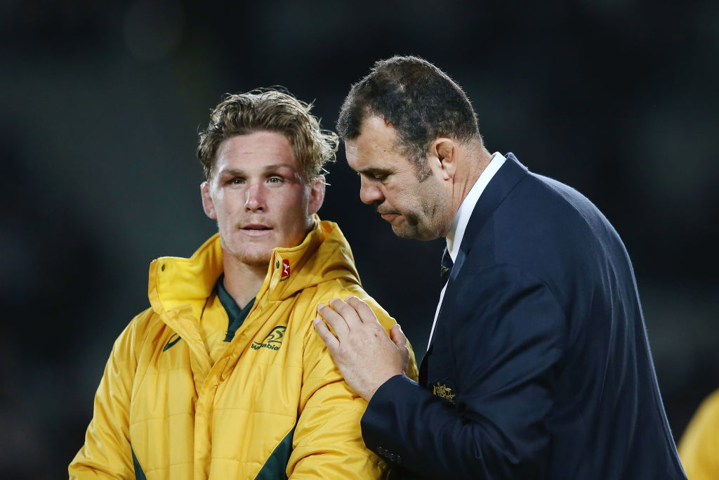 Wallabies coach Michael Cheika (R) consoles captain Michael Hooper after their loss to the All...