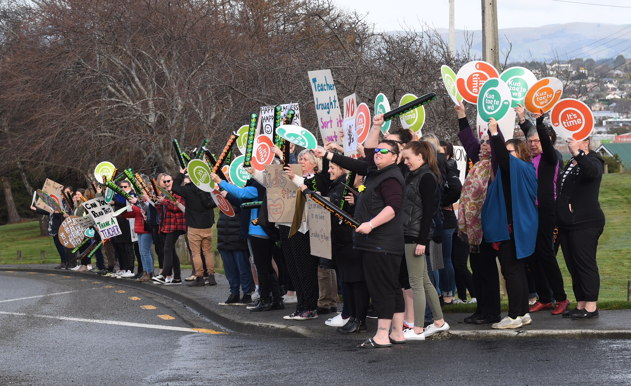 Striking South Otago NZEI members interact with SH1 motorists at Balclutha. Photo: Stephen Jaquiery
