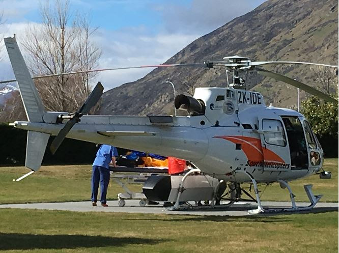 A Southern Lakes rescue helicopter unloads a man seriously injured in an avalanche at Lakes...