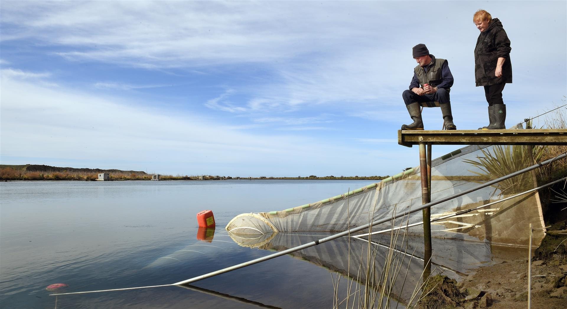 Colin and Christine Melvin at their whitebaiting stand near the Clutha River mouth yesterday. Photo: Stephen Jaquiery
