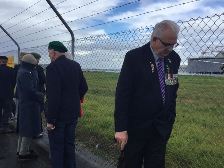 The Vietnam war veterans were only able to view the ceremony from some distance behind a wire...