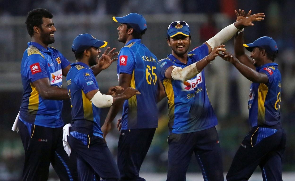 Sri Lankan players celebrate the dismissal of England's Sam Curran. Photo: Reuters
