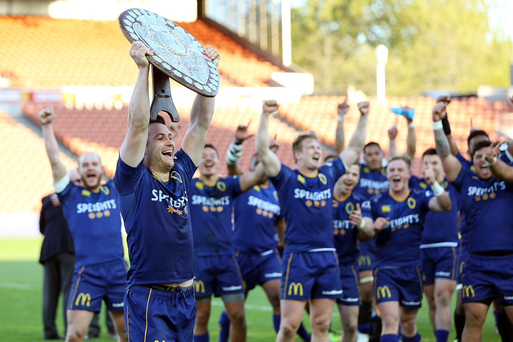 Otago's Michael Collins celebrates with the Ranfurly Shield during the round nine Mitre 10 Cup...