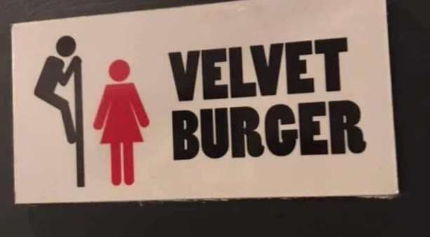 This sign in Velvet Burger's Fort St store in Auckland CBD, apparently indicated three self-contained toilets were unisex. Photo: Supplied via NZ Herald