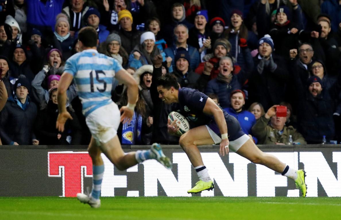 Sean Maitland crosses to score for Scotland against Argentina. Photo: Reuters