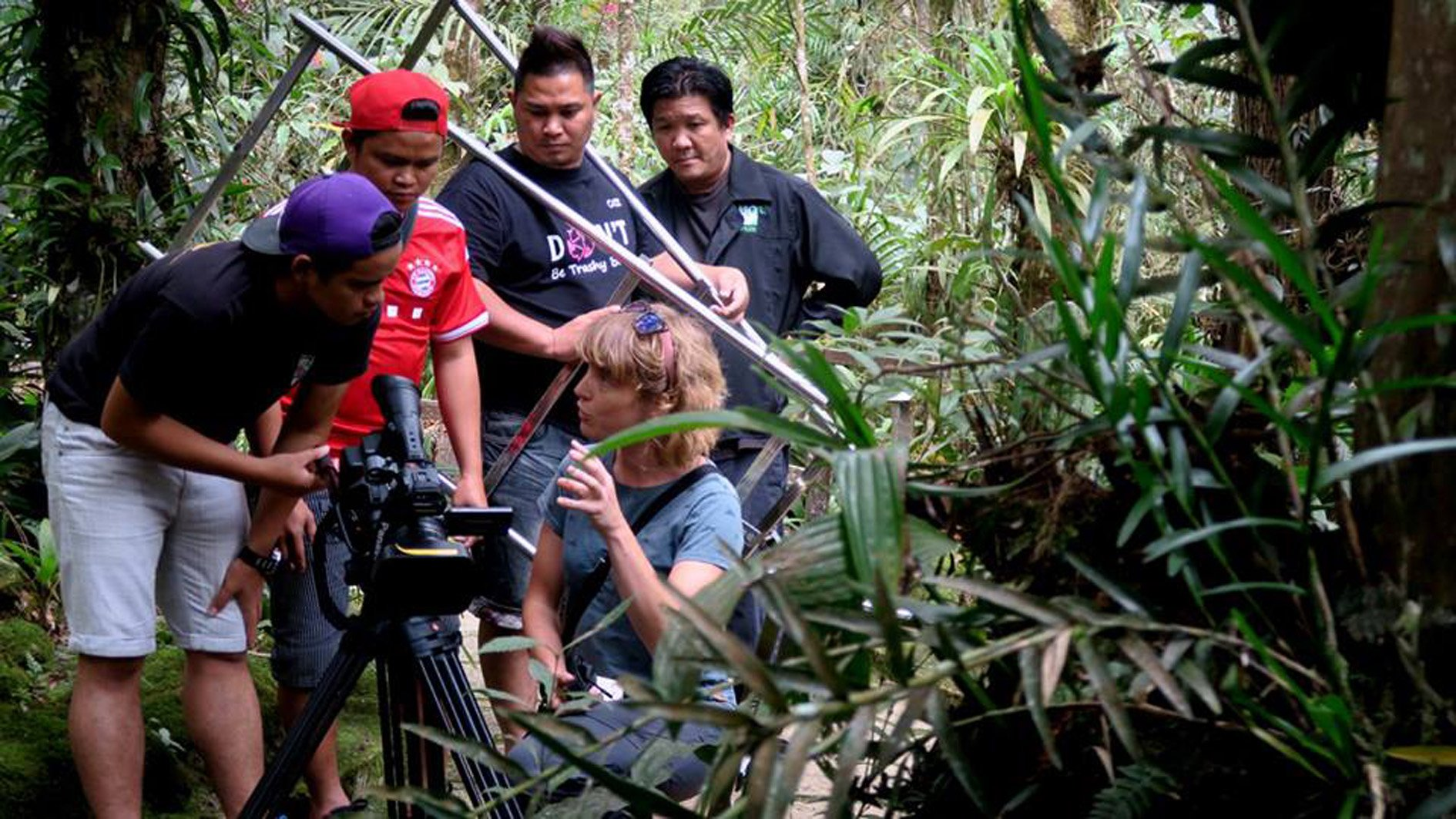 Wiebke Finkler, of the University of Otago, directs students from University College Sabah...